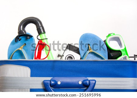 suitcase with beach items - stock photo