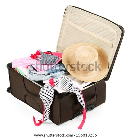 Suitcase with clothes isolated on white