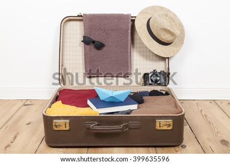 Suitcase with menswear - stock photo
