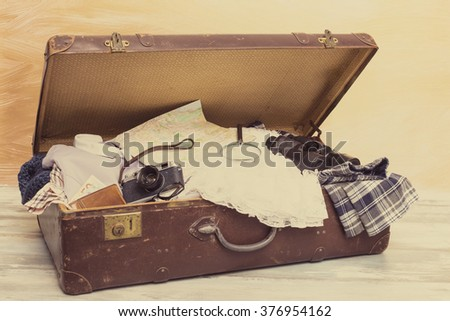 Suitcase with traveling stuff  - stock photo