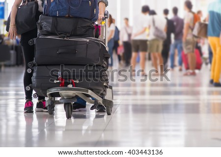 suitcases on a cart at the airport terminal. - stock photo