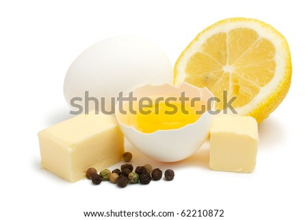 Suite of products for the preparation of Hollandaise sauce. All products are raw. Isolated on white background.