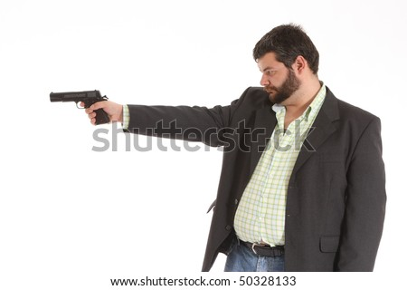 suited guy pointing a gun