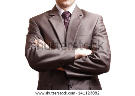 suited man with arms crossed in front - stock photo