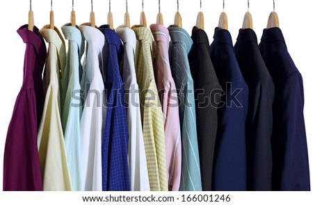 Suits and shirts on hangers isolated on white background - stock photo