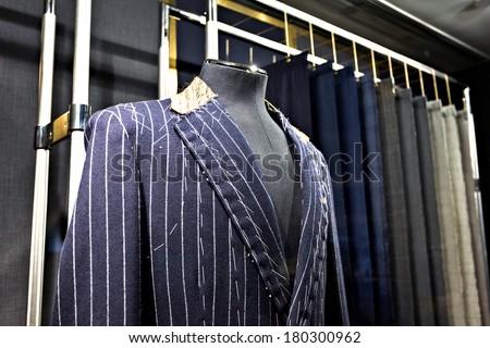 Suits on shop mannequins  - stock photo