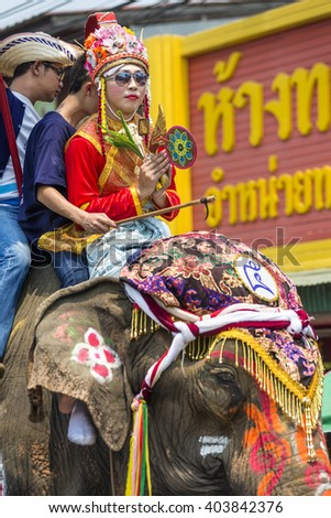 SUKHOTHAI, THAILAND - APRIL 7,2016 : Thai Puan the old Thai traditional ordained sitting on the back of an elephant parade festival riding crossing a river in the Sukhothai province THAILAND.