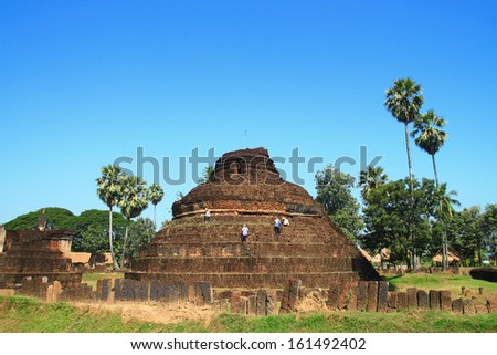 SUKHOTHAI,THAILAND - November 5:The ancient history of Pra Prang Temple in Sisatchanalai park,Thailand on November 5,2013 in Sukhothai.The city has been recognized by UNESCO as a World Heritage sites.