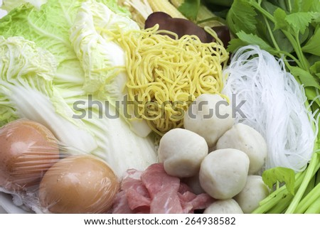 Sukiyaki, mixed vegetables, meat combinations are set on a plate. - stock photo