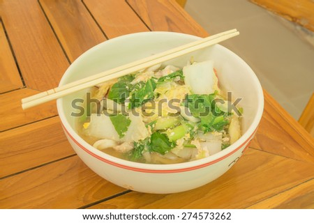 Sukiyaki or Japanese Dish in a Bowl on a Wooden Table - stock photo