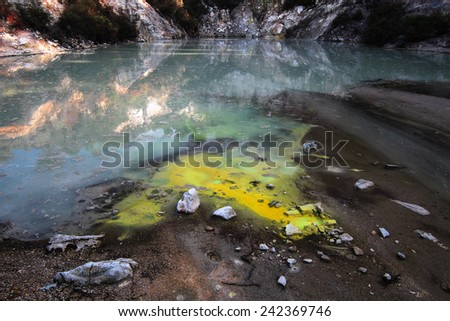 Sulfur Leaking into a Pond in a Geothermal Hotspot, Wai-O-Tapu, New Zealand - stock photo