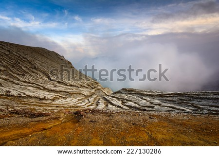 Sulphatic lake in a crater of volcano Ijen. Java, Indonesia - stock photo