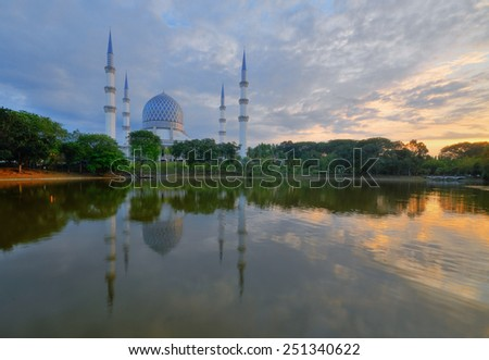 Sultan Salahuddin Abdul Aziz Shah mosque, Malaysia. Image has grain or subject is blurry or noise and soft focus when view at full resolution. (Shallow DOF, slight motion blur)  - stock photo