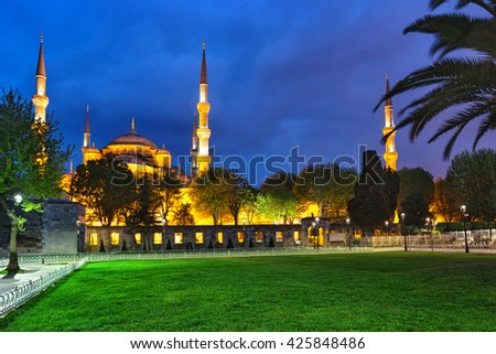 Sultanahmet Mosque (Blue Mosque) with lawn at night. Istanbul, Turkey. - stock photo