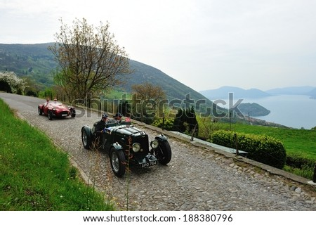 SULZANO, ITALY - APRIL 12: A green Aston Martin MK2, a red Ermini 1100 Sport take part to the Franciacorta Historic classic car race on April 12, 2014 in Sulzano. The car were built in 1935 and 1951. - stock photo