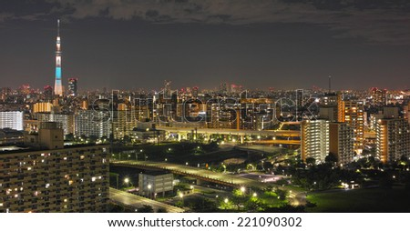SUMIDA, TOKYO - AUGUST 19, 2014: Tokyo Skytree illuminated with LED lights photographed at night. The landmark of Tokyo is the world's tallest tower (634m). - stock photo