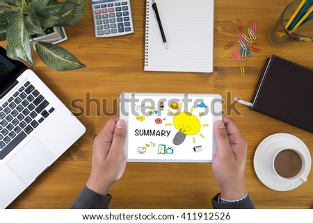 SUMMARY CONCECT Corporate identity mock up on an hardwood desk with laptop, tablet, smartphone and a cup of coffee, top view - stock photo