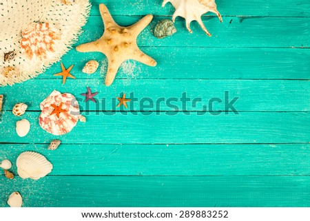 Summer accessories and shells on blue wooden background. - stock photo