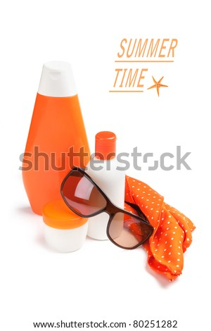 Summer accessories: body balm, sunscreen, facial cream, scarf and sunglasses on white background. - stock photo