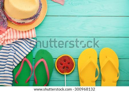 Summer accessories on blue wooden floor. Top view - stock photo