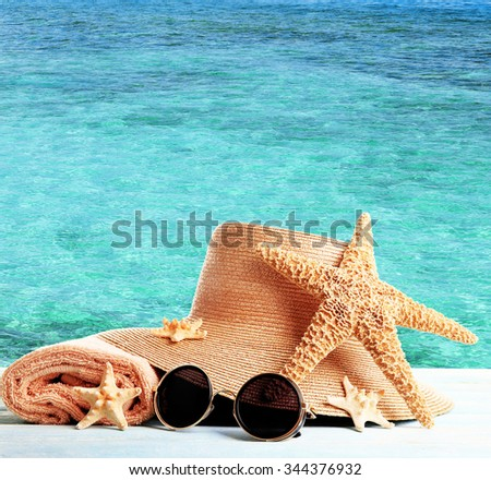 Summer accessories on sea background - stock photo