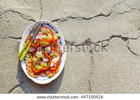summer autumn Salad with fresh Heirloom Tomatoes, sweet peppers, radishes, and green onion . on stone - stock photo