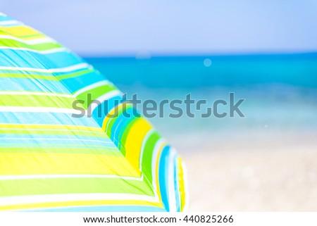 Summer Background - Beach Umbrella on Empty Sandy Beach - stock photo