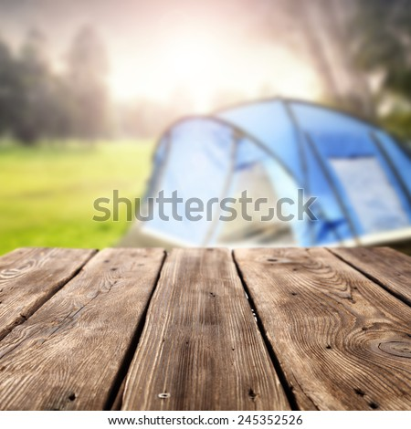 summer background of camping and table  - stock photo