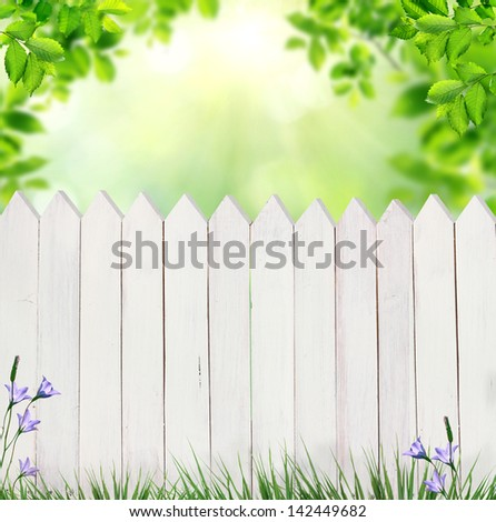 summer background with fence - stock photo