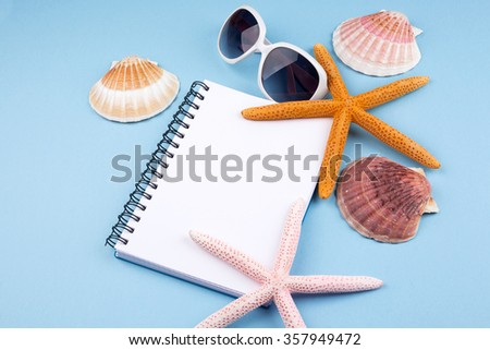 summer background with notebook,starfish and sea shells - stock photo