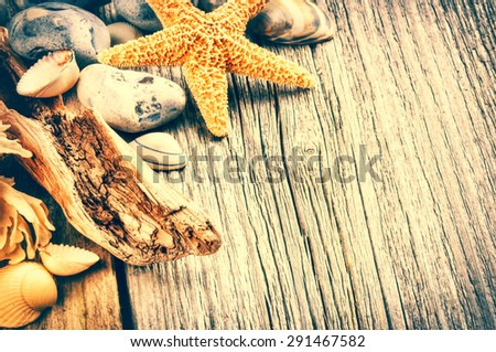 Summer background with pebbles and starfish - stock photo