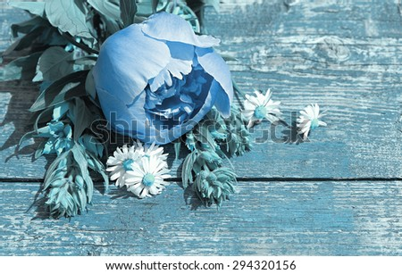 Summer background with wildflowers and peonies on an old table. Space for text. Art processing in a blue tint. - stock photo