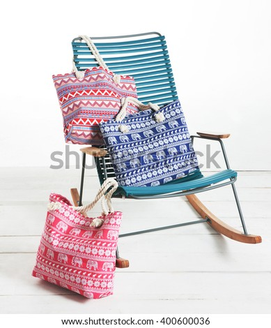 summer bags for the beach with a armchair for the beach on a studio photo - stock photo