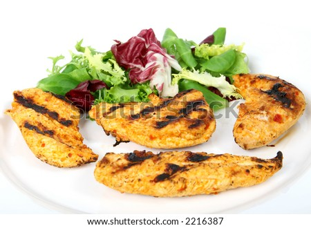 Summer barbeque chicken with green lettuce salad, macro close up isolated on white - stock photo