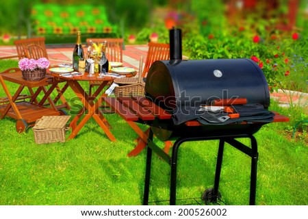 Summer BBQ Party or Picnic in backyard. HDR +Tilt-shift effect in background. - stock photo