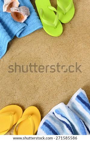 Summer beach background, towel, flip flops, copy space, vertical - stock photo