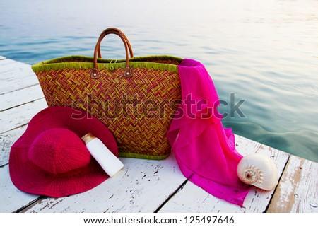 Summer beach -  beach bag and women's beach accessories - stock photo