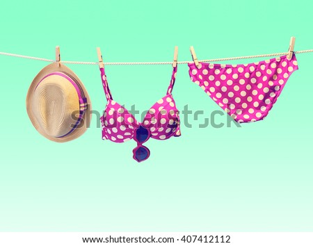 Summer Beach clothes and accessories stylish set. Fashion swimsuit bikini pink polka dots, sunglasses, hat on rope. Essentials creative tropical look. Ocean sea vacation concept, vintage - stock photo