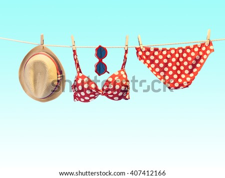 Summer Beach clothes and accessories stylish set. Fashion swimsuit bikini red polka dots, sunglasses, hat on rope. Essentials creative tropical look on blue. Ocean sea vacation concept,vintage - stock photo