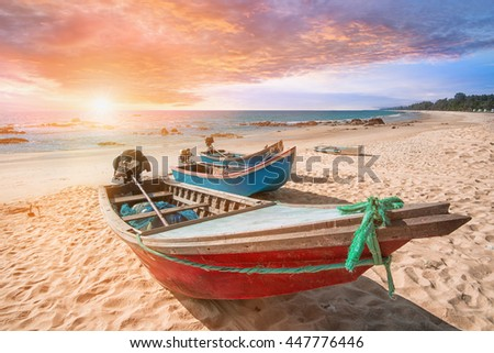 Summer beach in Krabi beach, with the boat during sunset at Thailand - stock photo