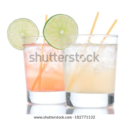 Summer beach margarita cocktails drink in spirit glasses isolated on a white background - stock photo