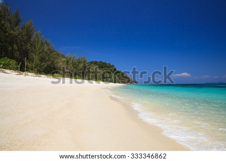 Summer beach scene - stock photo