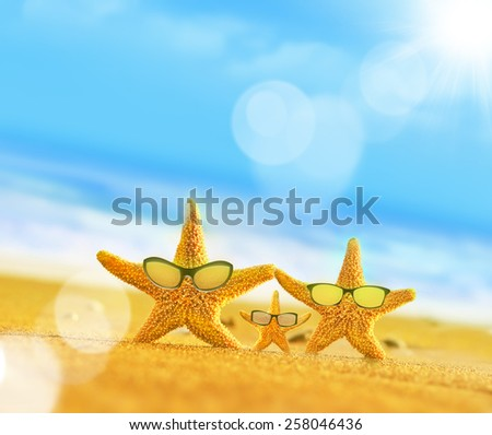 Summer beach. Starfish family in sunglasses on the seashore. Beach party. - stock photo