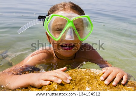 Summer beach, summer joy - lovely girl diver in the sea - stock photo