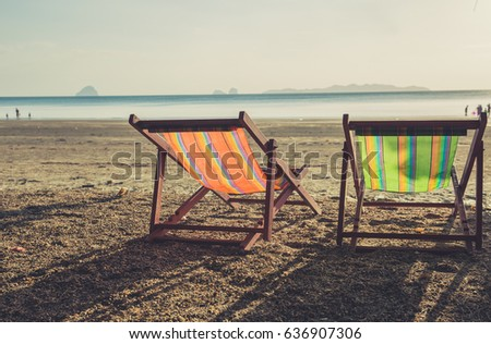 summer beach sunset with empty couple bed travel background.