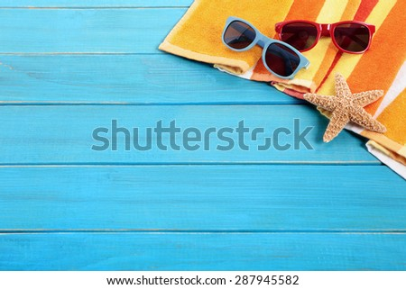Summer beach vacation, couple sunbathing background, sunglasses, copy space - stock photo