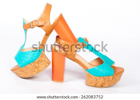 Summer beautiful high heels and beautiful earrings on a white background - stock photo