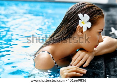Summer. Beautiful Sexy Young Woman, Girl With Healthy Skin In Bikini Relaxing In Swimming Pool Water In Resort Relax Spa Hotel. Holidays Vacation. Body Health Care, Beauty Concept. Lifestyle, Wellness - stock photo