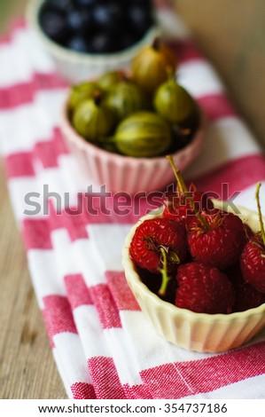 Summer berries, blueberries and raspberries, selective focus - stock photo