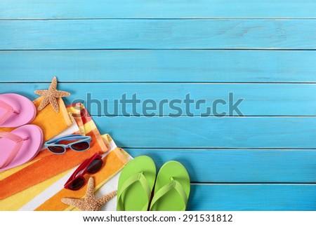 Summer border, beach background, sunglasses, blue wood deck, copy space - stock photo